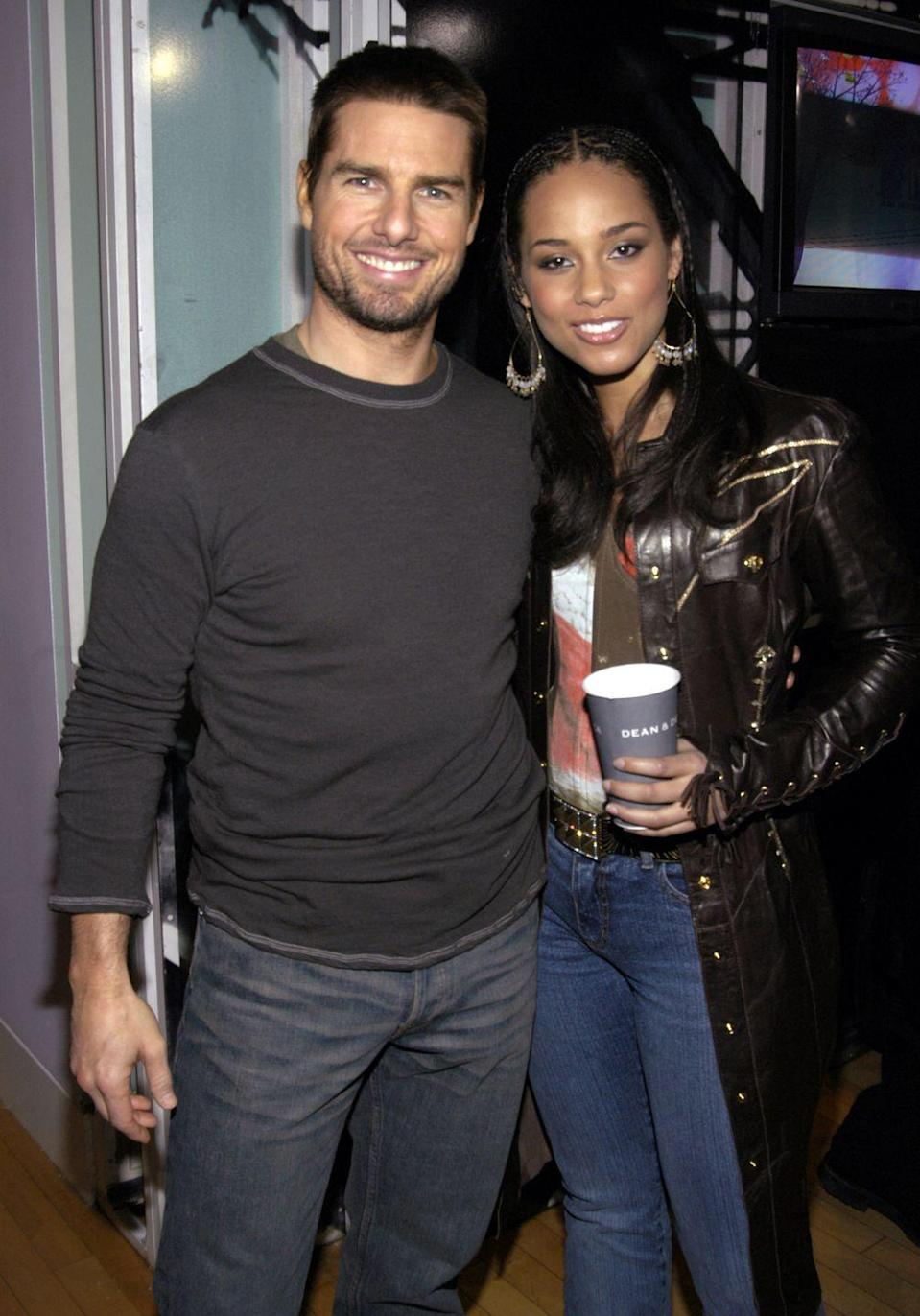 <p>Looking fit with Alicia Keys during a visit to MTV's <em>TRL</em> in New York City on Dec. 2, 2003.</p>