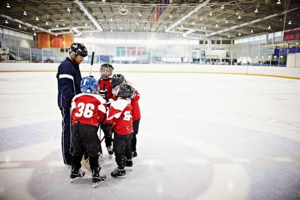 PHOTO: In this undated file photo, a coach encourages his team of young hockey players. (Thomas Barwick/Getty Images, FILE)