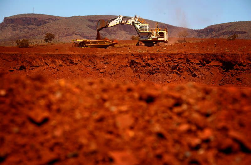 FILE PHOTO: File picture of a giant excavator loading a mining truck at the Fortescue Solomon iron ore mine south of Port Hedland
