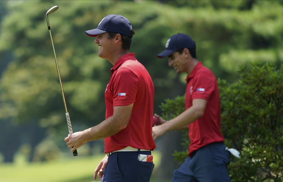 Chile's Mito Pereira, left, speaks with his teammate Joaquin Niemann during a practice round of the men's golf event at the 2020 Summer Olympics, Tuesday, July 27, 2021, at the Kasumigaseki Country Club in Kawagoe, Japan, (AP Photo/Matt York)