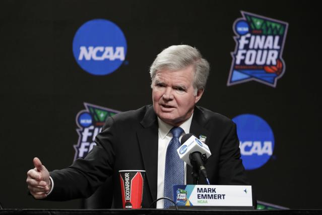 FILE - In this April 4, 2019, file photo, NCAA President Mark Emmert answers questions at a news conference at the Final Four college basketball tournament in Minneapolis. As Congress considers whether to allow college athletes to receive endorsement money, the NCAA and its allies spent nearly $1 million last year lobbying lawmakers to shape any reforms to the organization's liking. (AP Photo/Matt York, File)