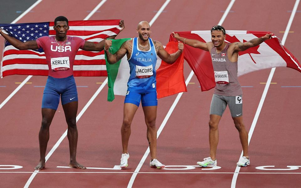 Bronze medallist Canada's Andre De Grasse, gold medallist Italy's Lamont Marcell Jacobs and silver medallist USA's Fred Kerley - AFP / Getty