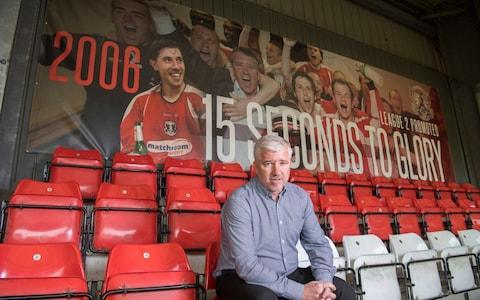 "If Martin Ling had been given a pound every time someone asked him if it was wise, given his medical history, to go back to work at Leyton Orient, he would be close to paying off the club's debt. Here was Ling, who had been obliged to leave his last two jobs in management after crippling bouts of depression, taking up the role of director of football at a club who have latterly redefined the term dysfunctional, a club mired in debt, decline and dispute. You can understand the surprise at his accepting the role: he was taking on a job that appears guaranteed to induce stress. ""Actually, I'm loving it,"" he smiles, as he sits in his office in the Brisbane Road stadium. ""I was worried my illness might scare people off. I knew another manager's job was very unlikely. So this really does feel like a second chance. And I'm buzzing off it."" Ling resigned as manager of Swindon Town in 2015 after only 52 days. He left because, despite winning his first few games, he could feel the advancing tide of the depression which had overwhelmed him when he was in charge at Torquay two years previously. It was an episode which left him shattered, hospitalised and undergoing electro-convulsive treatment, an experience from which he took a long time to recover. ""I don't know if it was football that caused it,"" he explains. ""I can't prove it was, but I can't prove it wasn't. I still take tablets, I still have counselling, I have to live with the fact I have depression. When it hits you, you think you've got it for life. But then, as suddenly as it arrives, it goes. And the fact is I feel brilliant today. I've felt brilliant for an awful lot of days in recent times."" Martin Ling Credit: Paul Grover What Ling did not want to do after he emerged from his darkness was hide away. An open, engaging, quick-witted presence, he has spent much of the past couple of years giving talks about the condition, he is always willing to have a coffee with someone who is suffering, always keen to widen general understanding of what it entails. And through it all he retained a keenness to get back to work in football, to tap into the experience he has gleaned over the years. So, when he got a call this summer to return to the club where he played and then managed with some success for six years, he did not hesitate. ""If I could have picked a job that best suited my skills, this is it,"" he says. ""I don't believe football management gave me depression, I think I would have got it in any walk of life. But I do believe football management is an all-encompassing, mind-never-sits-still, always-in-your-head type of job and I didn't want to test it again. Looking back, what I enjoyed was the managing element of being a football manager more than the coaching bit. I like managing people. And in this role I'm managing more people."" It is a job, he quickly discovered, that entails a lot of managing. Orient had been driven to the very brink of insolvency under the previous ownership of Francesco Becchetti. In his three years in charge, the Italian oversaw the club sinking from the League One play-off final to losing their league status for the first time in 112 years. In the process, he employed 10 managers, failed to pay staff for months on end and drove the supporters to despair. When Becchetti moved on in June, his legacy was an operation stripped of cash, purpose and morale. ""It was a massive car crash,"" is Ling's way of putting it. ""And there's still wreckage we're coming across on a daily basis, in terms of trying to restore our credit rating, in terms of debts. The place was shot."" Ling managed Orient when they were promoted to League One in 2006 Credit: Paul Grover To the rescue had come Nigel Travis, the chief executive of Dunkin' Donuts and a lifelong Orient fan, who, after tortuous negotiation with Becchetti, bought the club with his business partner, Kent Teague. Travis is full of enthusiasm and ideas for the club, how he is going to market them as an alternative to the corporate Premier League, how he is going to communicate with fans digitally, how he will develop a presence in the United States, where he lives and works. But before all that, the new owner required someone he could trust to run the operation and install the kind of stability destroyed by Becchetti's chaotic regime. The first person Travis thought of was the man whose picture adorns the back of the south stand at Brisbane Road, taken in celebration of the time he guided Orient to League One in 2006. ""Martin has all the qualities we needed,"" the new owner says, speaking on the phone from Texas. ""I believe business is all about people, and Martin captures that. He is brilliant with people."" He needs to be. What Ling discovered when he arrived at the stadium was a ghostly shell of a club. ""When I walked into this office on June 23, I had three staff members and nine players, the oldest one was 19. Everyone else had gone through the door,"" he recalls. ""We had no scouting network. We had no physio. Which meant we couldn't train."" Plus, he had no first-team manager. He recruited Steve Davis, the former Crewe manager, to whom he gave a fundamental reassurance. ""I know what it's like to sit in Steve's seat,"" he says. ""I know I'd have hated to have a director of football who was just sitting waiting to take my job, looking for something to go wrong. He knows I'm not interested in being manager, for very personal reasons."" Together, the pair recruited a squad, selling the new owners' ambitions to them. Initially, there was, according to Ling, ""a massive euphoria"" among fans that the club were finally out of the hands of Becchetti; more season tickets were sold than in any time in 16 years. But the director of football knew it would take time for a team so hurriedly assembled to gel. He knew that supporters might have to experience a few defeats along the way, as they did against AFC Fylde at home last weekend and away to Tranmere Rovers last night. ""Some of our supporters think, because they've not heard of these teams, we're going to railroad them. But simply being Leyton Orient wins you nothing. ""Opposing teams come to this lovely stadium and it's like a cup final for them. It's something we've got to get used to. This is a tough league to get out of. There were a few boos on Saturday. The best young players in world football ""I don't mind fans grumbling, they wouldn't be football fans if they didn't grumble. But one thing we're not going to do is panic."" And, though he has no timetable for achieving it, though it might take longer than some supporters assume, Ling believes everything is now in place to bring back the kind of success he once delivered here. ""People used to say about me when they heard I was ill, what have you got to be depressed about? I learned it doesn't work like that. It's a weird illness, I don't know where it comes from and I don't know where it goes,"" he says. ""But what I do know is, there is nowhere else I'd rather be than sat here now."""