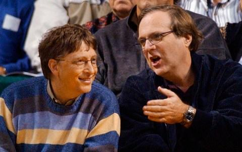 Microsoft Chairman Bill Gates, left, chats with Portland Trail Blazers owner and former business partner Paul Allen during a game between the Trail Blazers and Seattle SuperSonics in Seattle - Credit: AP