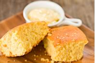 """<p>Corn was very popular back in the early days of the country, because corn was basically everywhere. It's not surprising that cornbread actually originated with the Native Americans. But back in those days, it didn't taste as great as it tastes now. According to <em><a href=""""https://www.southernliving.com/veggies/corn/southern-history-of-cornbread-video"""" rel=""""nofollow noopener"""" target=""""_blank"""" data-ylk=""""slk:Southern Living"""" class=""""link rapid-noclick-resp"""">Southern Living</a></em>, the original cornbread was just cornmeal and water stirred together, then baked over an open fire. It didn't start to get tasty until things like buttermilk and eggs became more common ingredients. </p>"""
