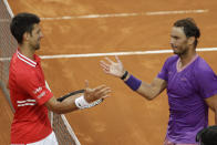 Spain's Rafael Nadal, right, greets Serbia's Novak Djokovic after deleting him at their final match of the Italian Open tennis tournament, in Rome, Sunday, May 16, 2021. Nadal won 7-5, 1-6, 6-3. (AP Photo/Gregorio Borgia)