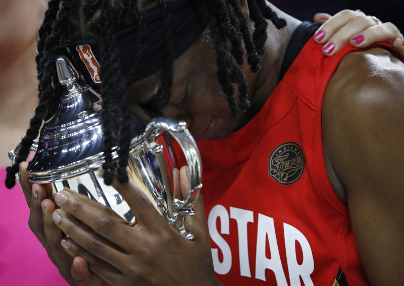 Indiana Fever's Erica Wheeler, of Team Wilson, cries as she holds the MVP trophy after winning the honor at the WNBA All-Star basketball game Saturday, July 27, 2019, in Las Vegas. (AP Photo/John Locher)