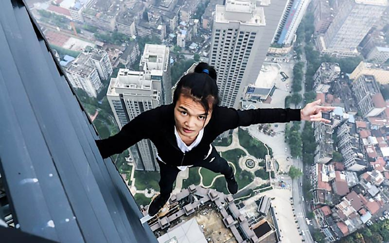 Wu Yongning was known for his daring feats on tall buildings - AsiaWire