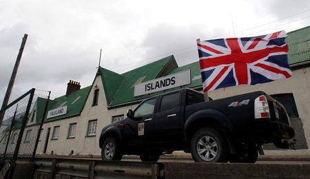"FILE PHOTO - A vehicle decorated with the Union Jack flag takes part in what was called a ""Victory"" rally in Stanley"