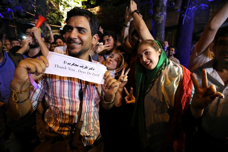 Iranians gather in celebration in northern Tehran on July 14, 2015, after Iran's nuclear negotiating team struck a deal with world powers in Vienna (AFP Photo/Atta Kenare)