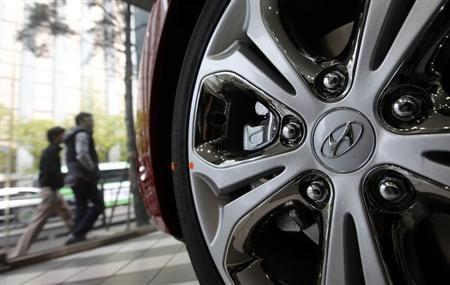 Logo of Hyundai Motor Co. is seen on a wheel of a car at a Hyundai dealership in Seoul