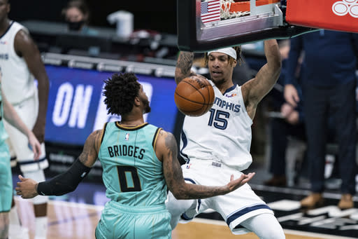 Memphis Grizzlies forward Brandon Clarke (15) dunks in front of Charlotte Hornets forward Miles Bridges (0) during the second half of an NBA basketball game in Charlotte, N.C., Friday, Jan. 1, 2021. (AP Photo/Jacob Kupferman)