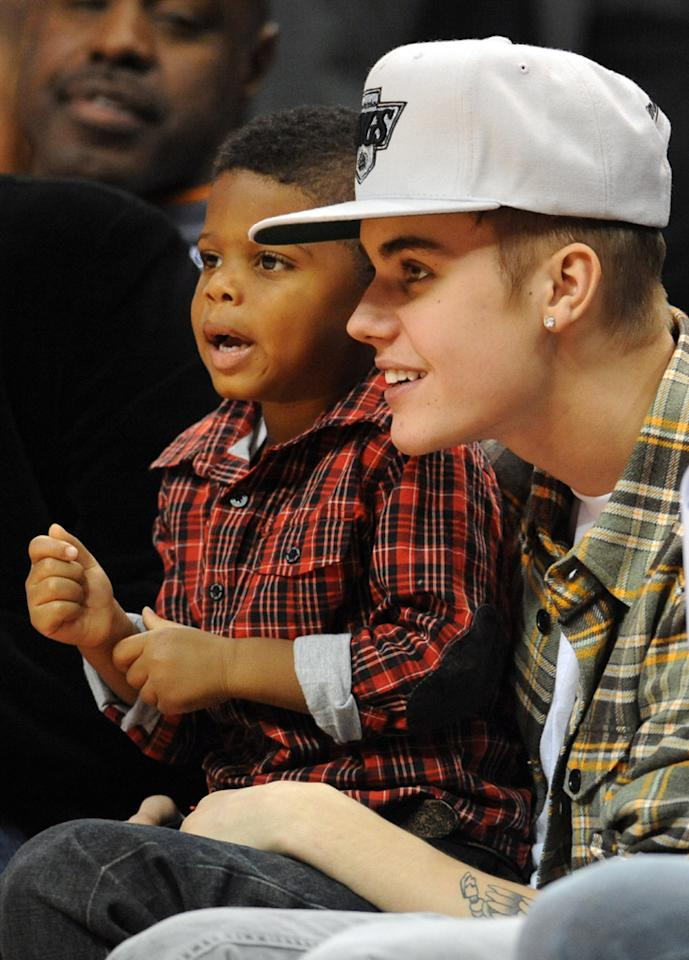 Justin Bieber and Chris Paul II, the son of LA Clippers player Chris Paul, watch Los Angeles Clippers play Boston Celtics in a NBA game at the Staples Center, Los Angeles, California.