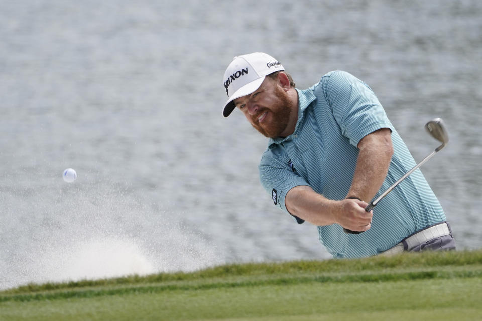 J.B. Holmes hits from a bunker on the first hole during the final round of the Honda Classic golf tournament, Sunday, March 21, 2021, in Palm Beach Gardens, Fla. (AP Photo/Marta Lavandier)