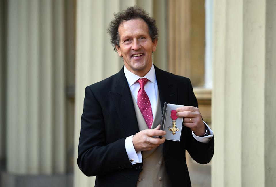 British broadcaster and horticulturalist Monty Don poses with his medal after being appointed an Officer of the Order of the British Empire (OBE) for services to broadcasting and charity during an investiture ceremony at Buckingham Palace in London on December 20, 2018. (Photo by Kirsty O'Connor/AFP via Getty Images)