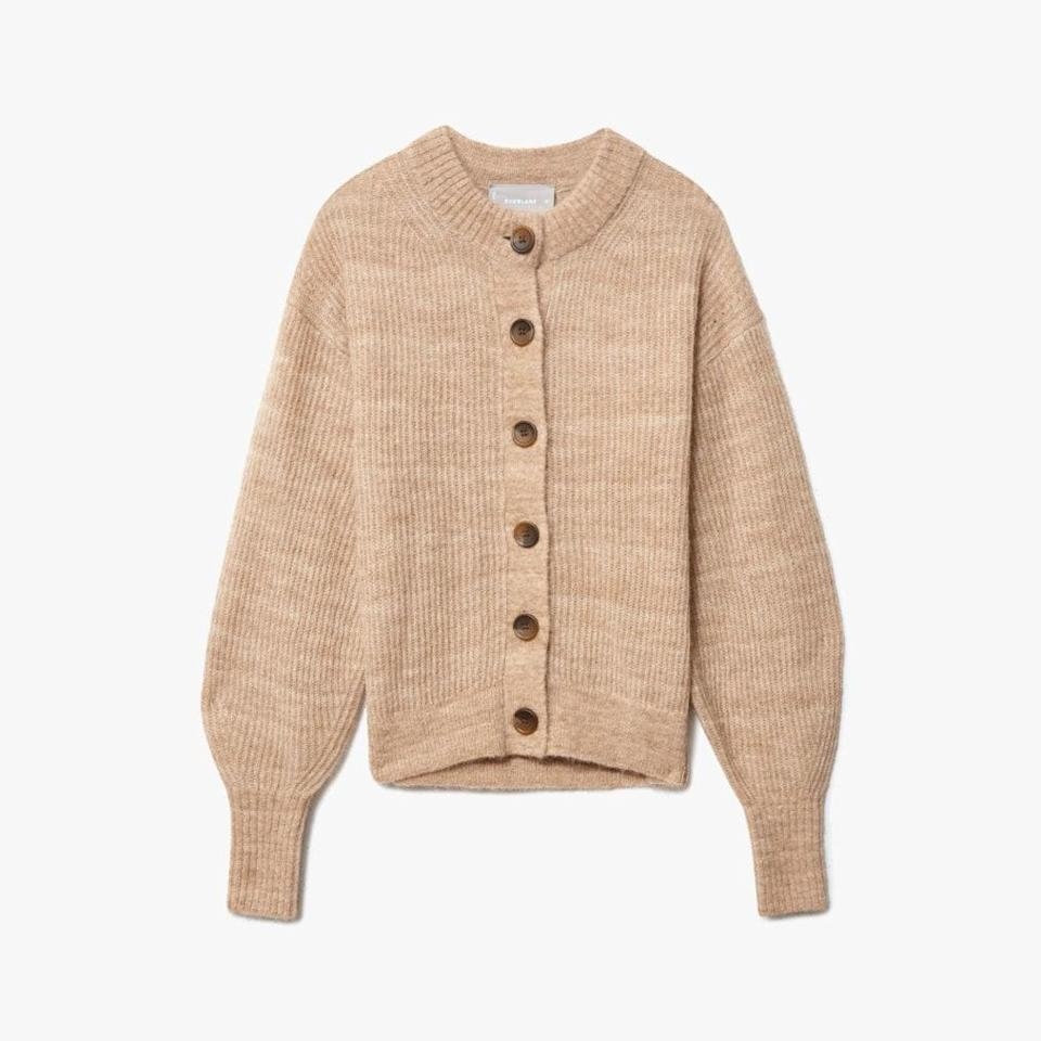 """Not that it's a competition or anything, but <em>Vogue</em> editors can't stop talking about this one. $110, EVERLANE. <a href=""""https://www.everlane.com/products/womens-cropped-alpaca-cardigan-heather-chai"""" rel=""""nofollow noopener"""" target=""""_blank"""" data-ylk=""""slk:Get it now!"""" class=""""link rapid-noclick-resp"""">Get it now!</a>"""