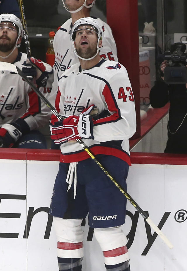 Washington Capitals' Tom Wilson watches the video screen after he scored a goal on Minnesota Wild goalie Devan Dubnyk in the first period of an NHL hockey game Tuesday, Nov. 13, 2018, in St. Paul, Minn. Wilson returned to the lineup after his 20-game suspension was reduced to 14 by a neutral arbitrator. (AP Photo/Jim Mone)