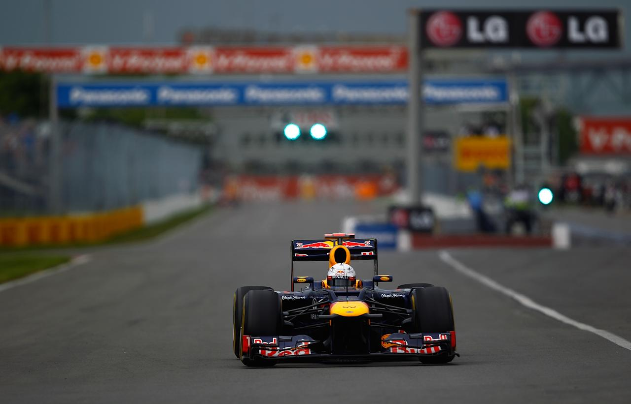 MONTREAL, CANADA - JUNE 08:  Sebastian Vettel of Germany and Red Bull Racing drives during practice for the Canadian Formula One Grand Prix at the Circuit Gilles Villeneuve on June 8, 2012 in Montreal, Canada.  (Photo by Vladimir Rys/Getty Images)