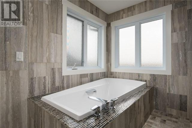 <p><span>209 Trillium Rd., Fort McMurray, Alta.</span><br> There are also four bathrooms, including the master ensuite with large tub and a travertine tile shower.<br> (Photo: Zoocasa) </p>