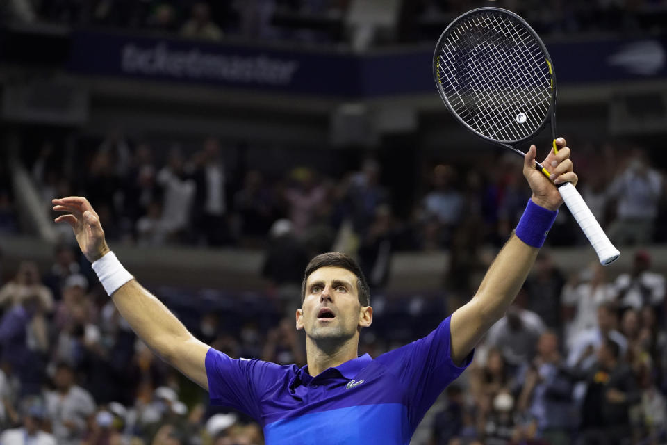 Novak Djokovic, of Serbia, reacts after defeating Alexander Zverev, of Germany, during the semifinals of the US Open tennis championships, Friday, Sept. 10, 2021, in New York. (AP Photo/John Minchillo)
