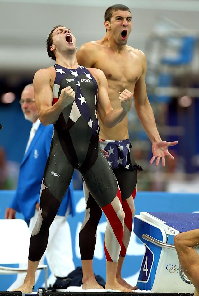 BEIJING - AUGUST 11: (L-R) Garrett Weber-Gale and Michael Phelps of the United States celebrate finishing the Men's 4 x 100m Freestyle Relay Final in first place to win the gold medal held at the National Aquatics Center on Day 3 of the Beijing 2008 Olympic Games on August 11, 2008 in Beijing, China.The United States finished the race in first place in a time of 3:08.24 and wins the gold medal and set a new World Record. (Photo by Mike Hewitt/Getty Images)