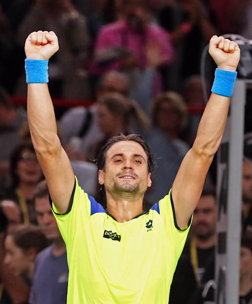 Spain's David Ferrer reacts after winning his semifinal match against Spain's Rafael Nadal, at the Paris Masters tennis, in the Paris Bercy stadium, Saturday Nov. 2, 2013. (AP Photo/Remy de la Mauviniere)