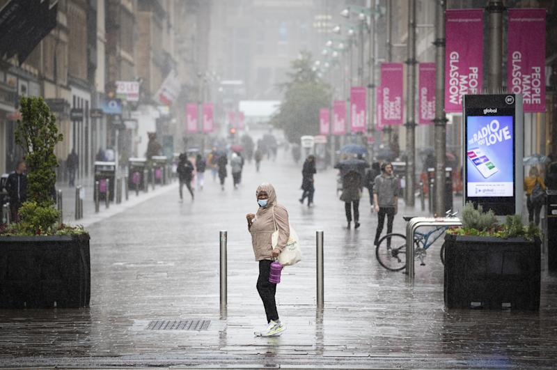 Members of the public caught in heavy rain in Glasgow city centre.