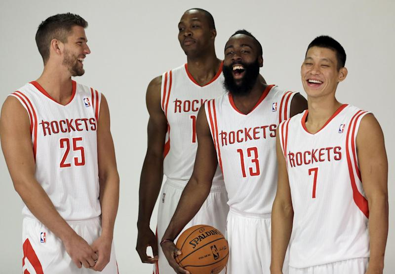CORRECTS IDS - Houston Rockets players, from left, Chandler Parsons, Dwight Howard, James Harden and Jeremy Lin laugh as they pose during NBA basketball media day Friday, Sept. 27, 2013, in Houston. Howard signed with the Rockets in the offseason. (AP Photo/David J. Phillip)