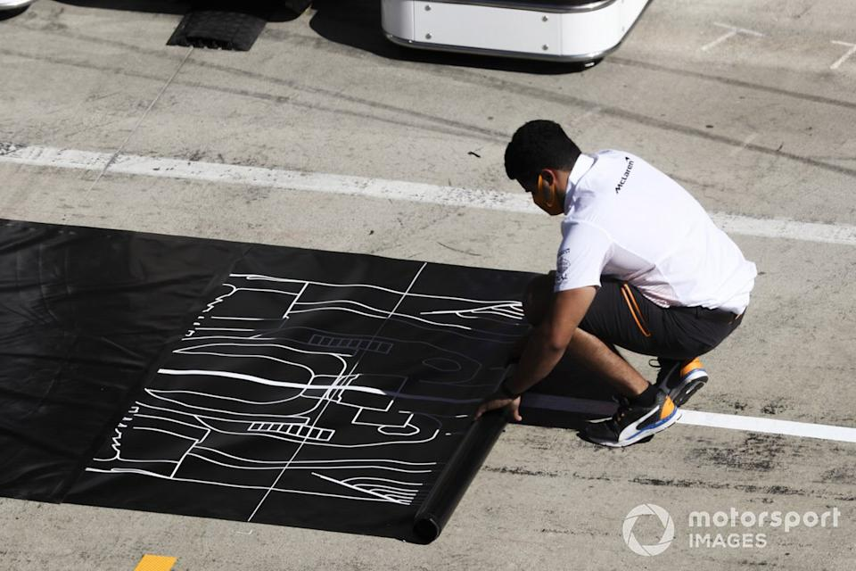 "McLaren Team Member in the pit lane<span class=""copyright"">Charles Coates / Motorsport Images</span>"