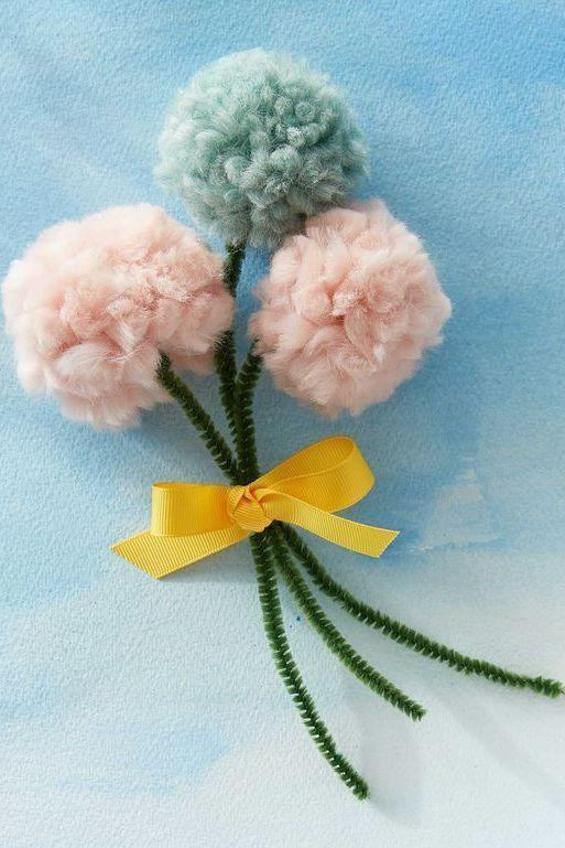 """<p>All you need is some yarn, ribbon, and pipe cleaners to make a cutesy bouquet of pom pom flowers. </p><p><strong><em>Get the tutorial at <a href=""""https://www.countryliving.com/diy-crafts/g4233/mothers-day-crafts-kids/"""" rel=""""nofollow noopener"""" target=""""_blank"""" data-ylk=""""slk:Country Living"""" class=""""link rapid-noclick-resp"""">Country Living</a>. </em></strong></p>"""