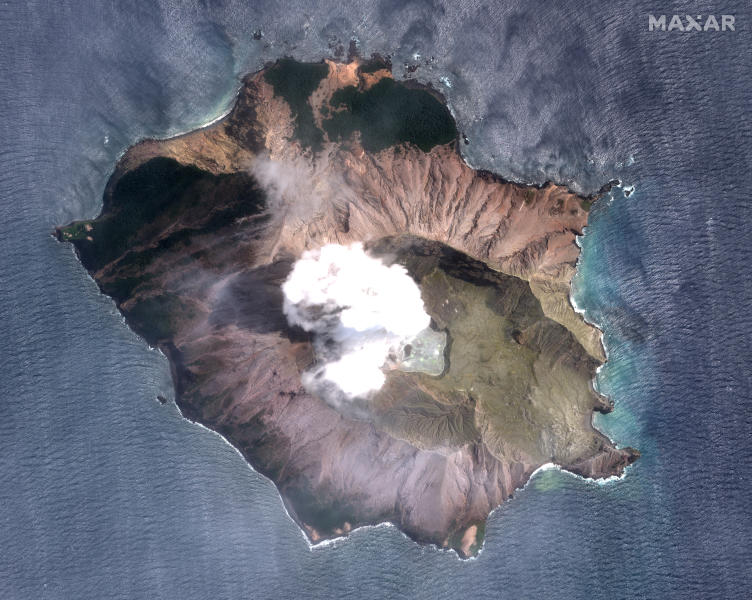 In this satellite image taken and released on Dec. 11, 2019, by Maxar Technologies steam rises from the volcano on White Island off the coast of Whakatane, New Zealand. A New Zealand island volcano vented more steam and mud Wednesday in an increase of geothermal activity that again delayed the recovery of victims' bodies from a deadly eruption two days ago. (Satellite image ©2019 Maxar Technologies via AP)