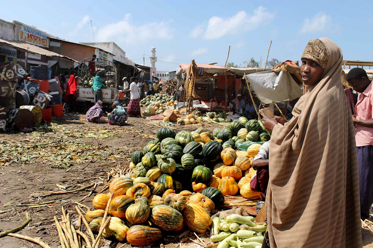 In this photo taken Thursday, March 29, 2012, Somali women sell fruit and vegetables at the Hamarweyne market in Mogadishu, Somalia. The seaside capital of Mogadishu is full of life for the first time in 20 years after African Union and Somali troops pushed Islamist militants out of the city last year. (AP Photo/Farah Abdi Warsameh)