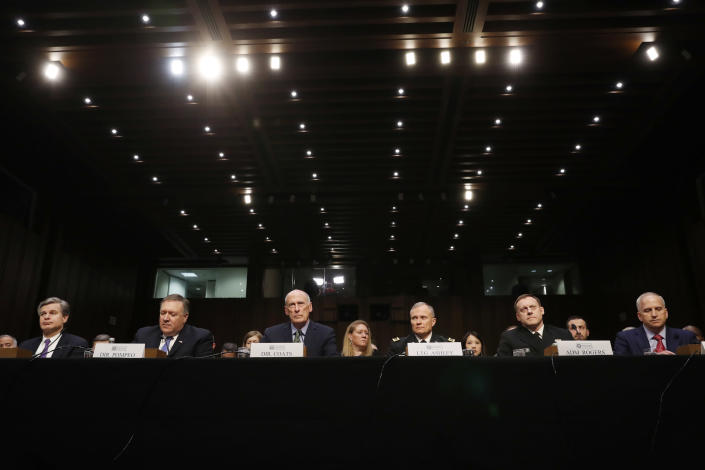 FBI Director Christopher Wray, CIA Director Mike Pompeo, Director of National Intelligence Dan Coats, Defense Intelligence Agency Director Robert Ashley, National Security Agency Director Michael Rogers and National Geospatial-Intelligence Agency Director Robert Cardillo testify before the Senate Intelligence Committee on Tuesday. (Photo: Leah Millis/Reuters)
