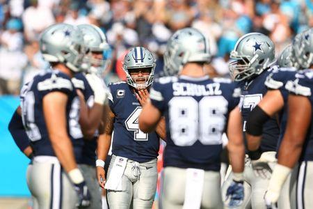 Sep 9, 2018; Charlotte, NC, USA; Dallas Cowboys quarterback Dak Prescott (4) huddles with the offense in the first quarter against the Carolina Panthers at Bank of America Stadium. Mandatory Credit: Jeremy Brevard-USA TODAY Sports