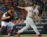 Cleveland Indians' Michael Bourn, right, strikes out swinging in front of Atlanta Braves catcher Brian McCann during the fifth inning of a baseball game at Turner Field, Tuesday, Aug. 27, 2013, in Atlanta. (AP Photo/David Tulis)
