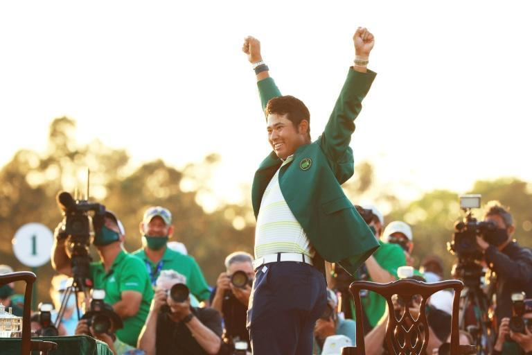 Hideki Matsuyama celebrates after becoming the first Japanese man to win a golf major with his victory at Sunday's Masters