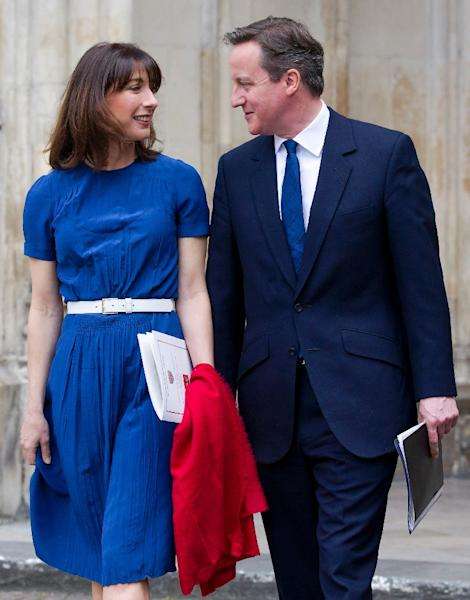 David Cameron and his wife Samantha will live at 10 Downing Street for another five years after Cameron's Conservatives won this month's general election (AFP Photo/Justin Tallis)