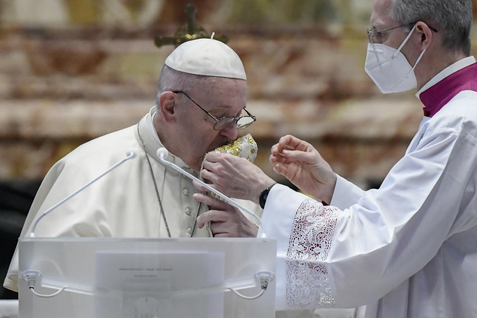 Pope Francis kisses the stole within delivering his Urbi et Orbi Blessing after celebrating Easter Mass at St. Peter's Basilica at The Vatican Sunday, April 4, 2021, during the Covid-19 coronavirus pandemic. (Filippo Monteforte/Pool photo via AP)