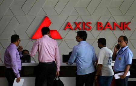 Axis Bank net falls 16%, net NPAs rise