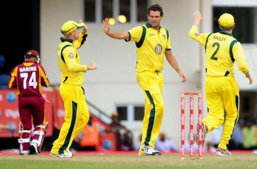 Australian cricketer Clint McKay (C) celebrates with teammates after dismissing West Indies batsman Sunil Narine (L) during the fifth-of-five One Day International (ODI) matches between West Indies and Australia at the Beausejour Cricket Ground in Gros Islet, St. Lucia. West Indies' hopes of a first series win over Australia in 17 years were shattered when the tourists clinched a 30-run victory