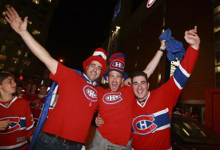 Montreal Canadiens fans celebrate their NHL Game 7 win over the Boston Bruins in Montreal
