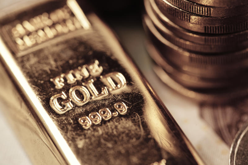 A gold bar and coins