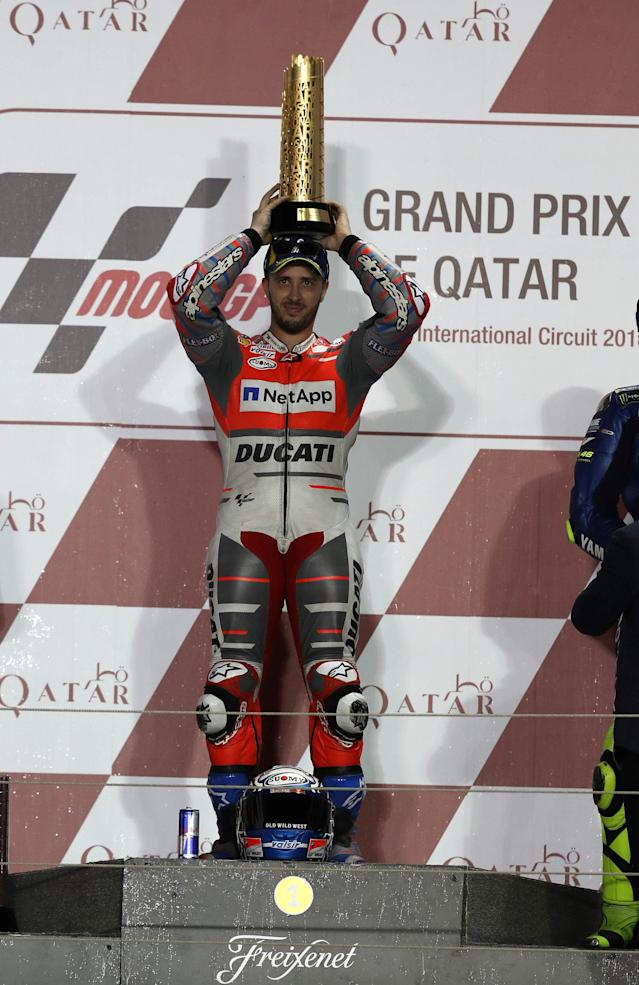 Motorcycle Racing - Qatar Motorcycle Grand Prix - MotoGP race - Losail, Qatar - March 18, 2018 - Ducati Team rider Andrea Dovizioso of Italy holds up the trophy. REUTERS/Ibraheem Al Omari
