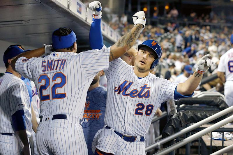 Jul 2, 2019; New York City, NY, USA; New York Mets left fielder J.D. Davis (28) celebrates his solo home run against the New York Yankees with left fielder Dominic Smith (22) during the sixth inning at Citi Field. Mandatory Credit: Brad Penner-USA TODAY Sports