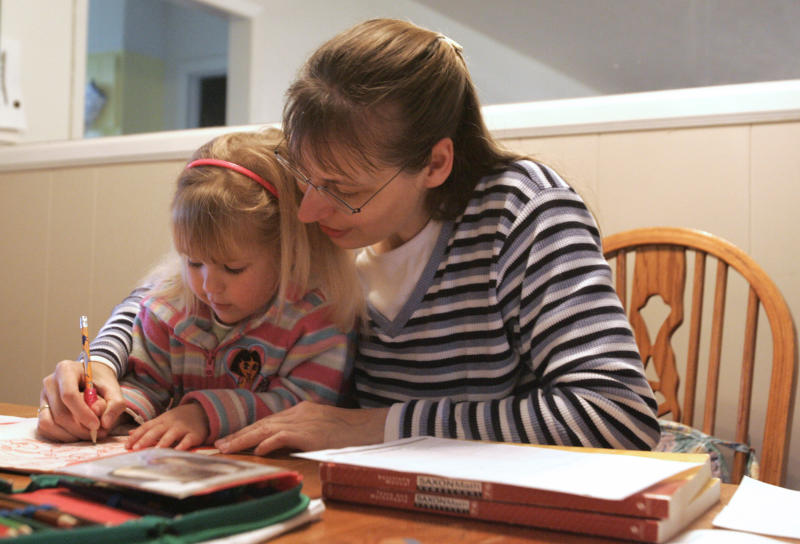 FILE -- This March 13, 2009, file photo shows Hannelore Romeike working with her daughter, Damaris, then 3, at their home in Morristown, Tenn. Hannelore Romeike and her husband fled Germany with their five children over fears that they would lose custody for not sending the children to school, and are now asking a federal appeals court to grant them asylum in the U.S. (AP Photo/Wade Payne, File)