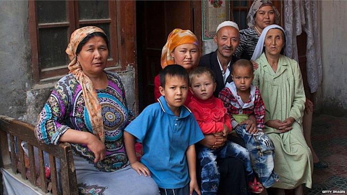 Uighur family pictured outside their home