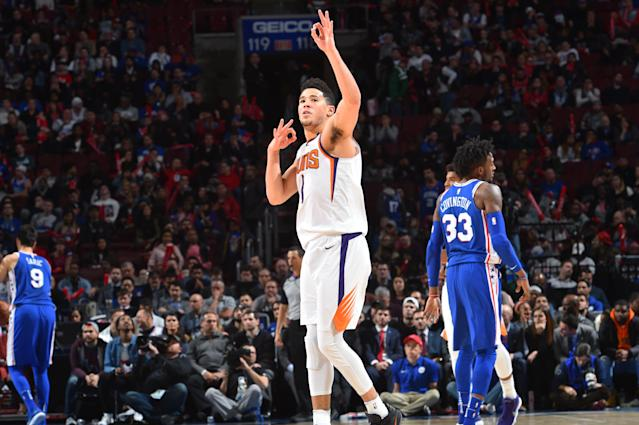 "<a class=""link rapid-noclick-resp"" href=""/nba/players/5473/"" data-ylk=""slk:Devin Booker"">Devin Booker</a> dances on the 76ers' home court. You can do that when you go nova. (Getty)"
