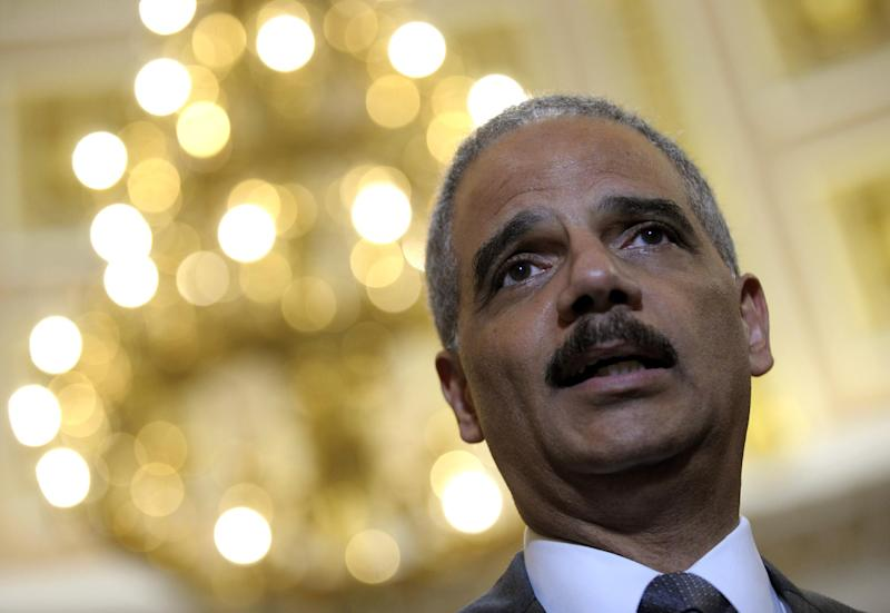 Attorney General Eric holder speaks to reporters following his meeting on Capitol Hill in Washington, Tuesday, June 19, 2012. Holder wants a House panel to drop plans to try to hold him in contempt of Congress, and the panel's chairman wants more Justice Department documents regarding Operation Fast and Furious, a flawed gun-smuggling probe in Arizona. Holder and Rep. Issa met in an effort to resolve their dispute over the investigation of Fast and Furious by the House Oversight and Government Reform Committee that Issa chairs.(AP Photo/Susan Walsh)