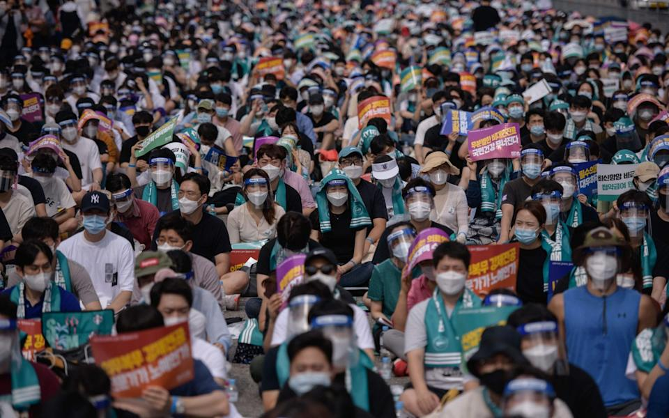 Doctors, medical students and healthcare professionals attend a rally in the Yeouido district of Seoul to protest against a South Korean government proposal to increase its annual intake of medical students - ED JONES/AFP