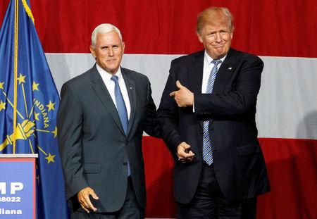 Republican presidential candidate Donald Trump (R) and Indiana Governor Mike Pence (L) wave to the crowd before addressing the crowd during a campaign stop at the Grand Park Events Center in Westfield, Indiana, July 12, 2016. REUTERS/John Sommers II